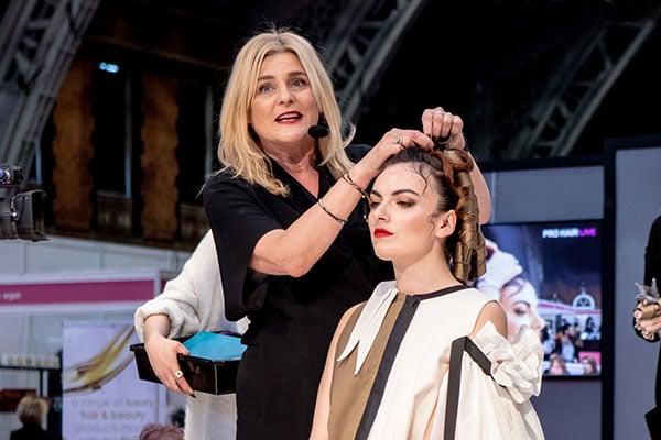 Karine Jackson demonstrating Curlformers at Pro Hair Live